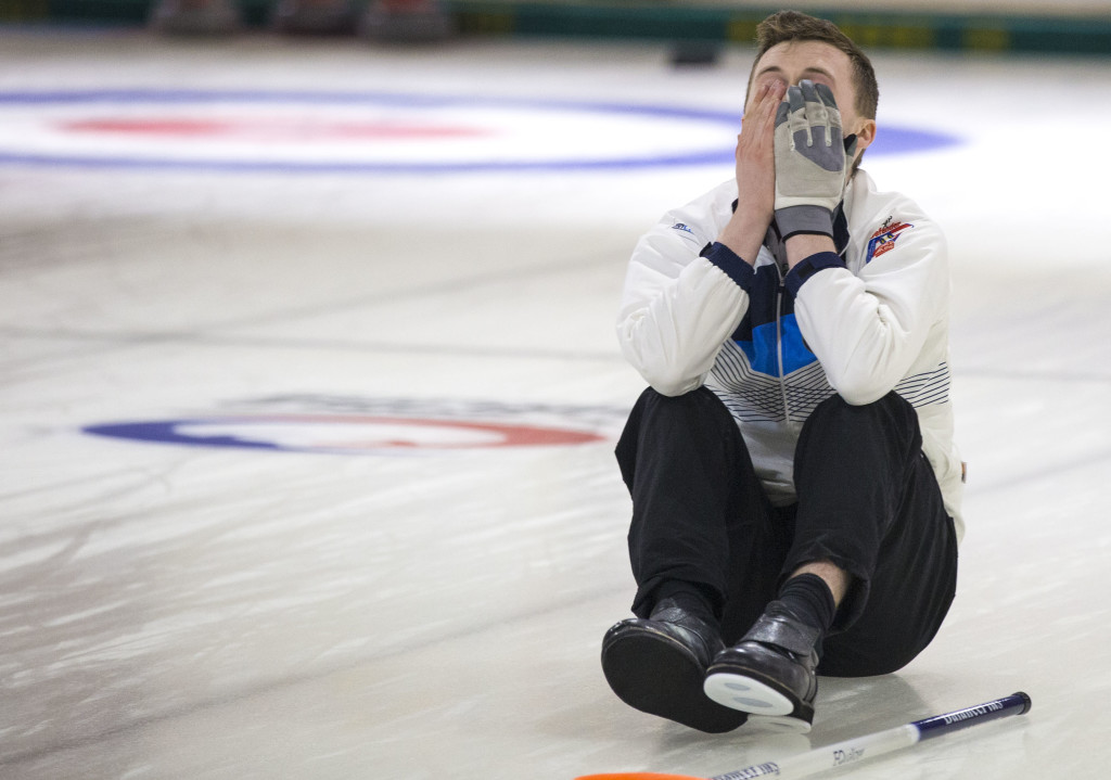 "Scottish skip Bruce Mouat slides to the ice after winning the VoIP Defender World Junior Curling Championships 2016 on March 13, 2016. "" I feel a lot more relaxed than I thought I was going to be,"" said Mouat. ""I was quite chilled. We controlled that game from the start and that probably contributed to how I felt."" Photo by Marissa Tiel"