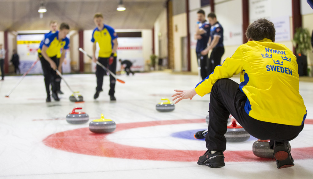 Fredrik Nyman vice-skip for Team Sweden watches a rock as it approaches the house on day four of the VoIP Defender World Junior Curling Championships 2016. Photo by Marissa Tiel