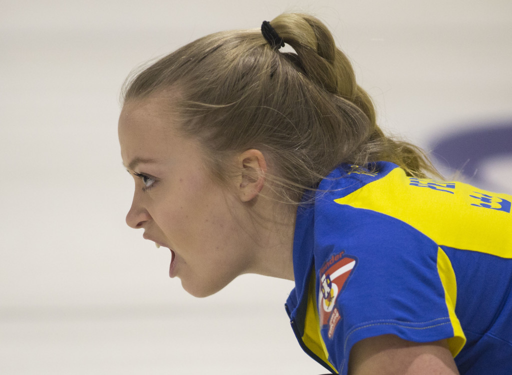 Sarah Pengel of Team Sweden shouts as she watches her shot go down the ice. The Swedish women's team placed fifth at the VoIP Defender World Junior Curling Championships 2016 in Tarrnby, Denmark. Photo by Marissa Tiel