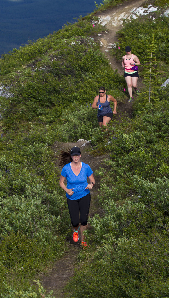 Marisa Johnson leads Tammy Neunherz and Dayna Woodford during a race at the top of Grey Mountain the night of Thursday, June 24, 2016. Photo by Marissa Tiel