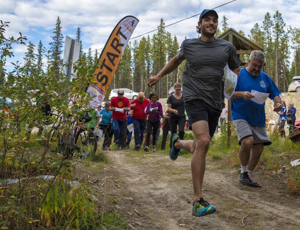 Athletes take part in a mass start during a fun orienteering relay near Kopper King on Wednesday, Aug. 11, 2016. Photo by Marissa Tiel