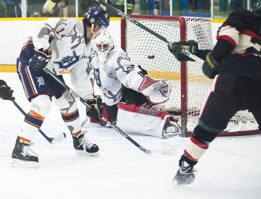 Andrew Pettitt shoots on Kainai Braves goalieTyler Cutknife during first period Senior AA hockey action. The Nuway Crushing Whitehorse Huskies host the Kainai Braves during the second of two exhibition games in Whitehorse, YT at Takhini Arena on Jan. 8, 2017.  At the end of the first period, the Huskies were up by five.