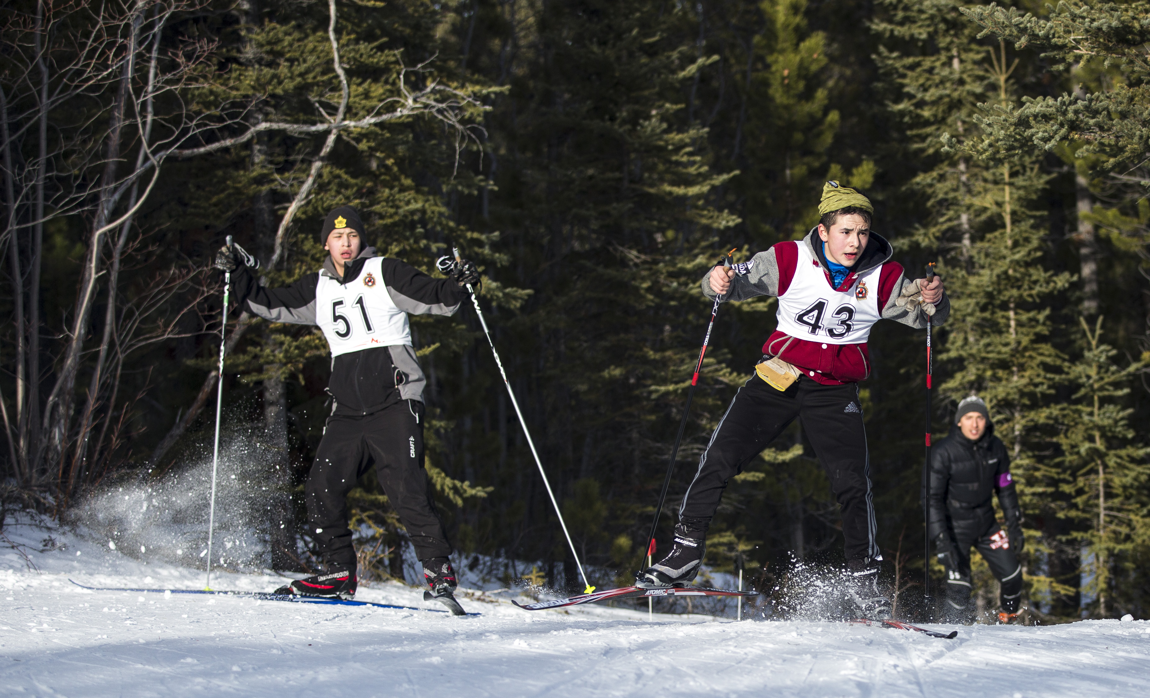 Cyril Angulalik (right) and Colin Tilley take part in the Northern Territorial Cadet Biathlon Championships at Grey Mountain in Whitehorse on Feb. 12, 2017. Photo by Marissa Tiel