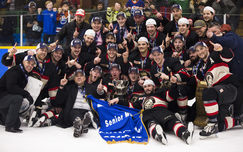 The Huskies pose with their gold medals and the Coy Cup during Coy Cup finals action at Takhini Arena on April 1, 2017. The Huskies won the Coy Cup 7-5.