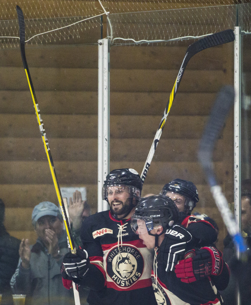 From left, Kevin Petovello and Derek Klassen celebrate a goal during Coy Cup round-robin action at Takhini Arena on March 29, 2017.
