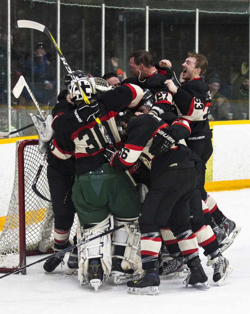 The Huskies celebrate during Coy Cup finals action at Takhini Arena on April 1, 2017. The Huskies won the Coy Cup 7-5.