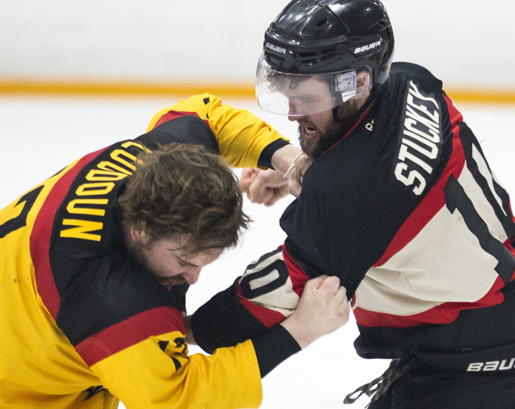 Kelly Loudoun, of the Kelowna Sparta, and Rob Stuckey, of the Whitehorse Huskies, fight during the second period of the Coy Cup finals at Takhini Arena.
