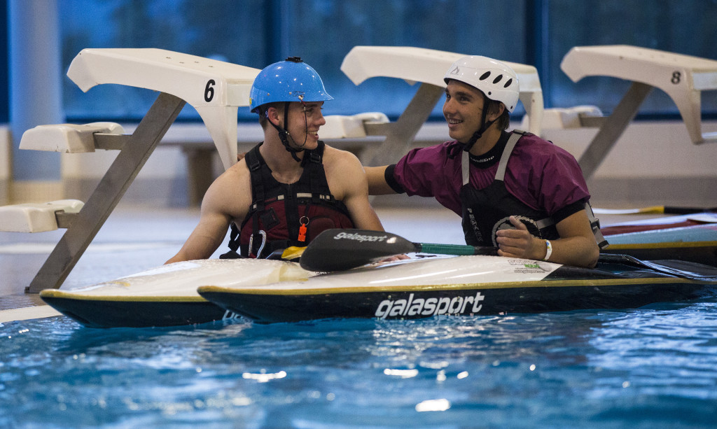 From left, Logan Kruse and Mael Pronovost relax between runs during the second annual YCKC Indoor Slalom Race at the Canada Games Centre last Friday.
