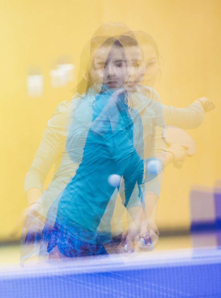 In this multiple exposure photo, Kate Crocker returns the ball during warm-up for the women's open competition at the Yukon Table Tennis Championships Saturday at Elijah Smith Elementary School.