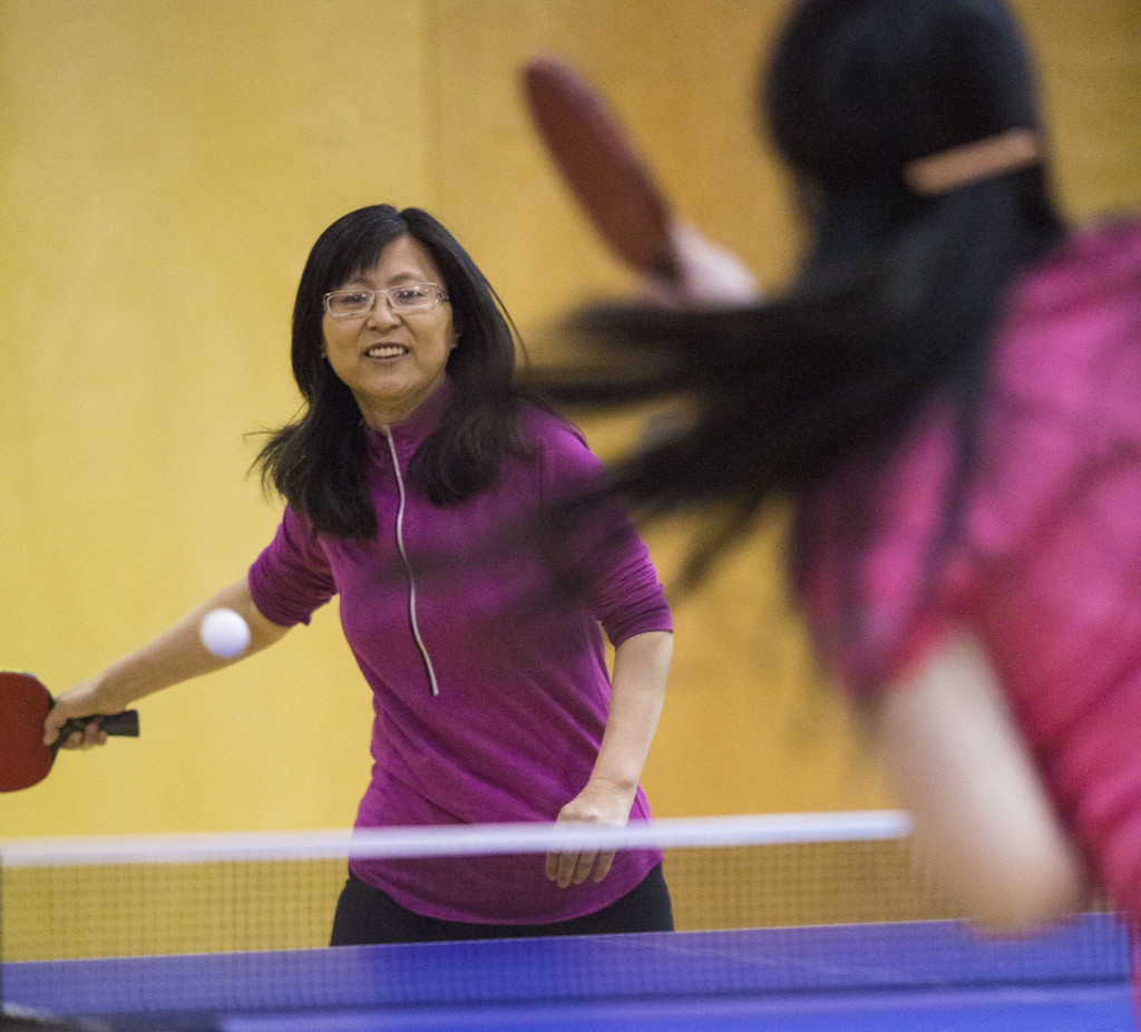Xui Mei Zhang returns the ball during the women's open competition at the Yukon Table Tennis Championships Saturday at Elijah Smith Elementary School.