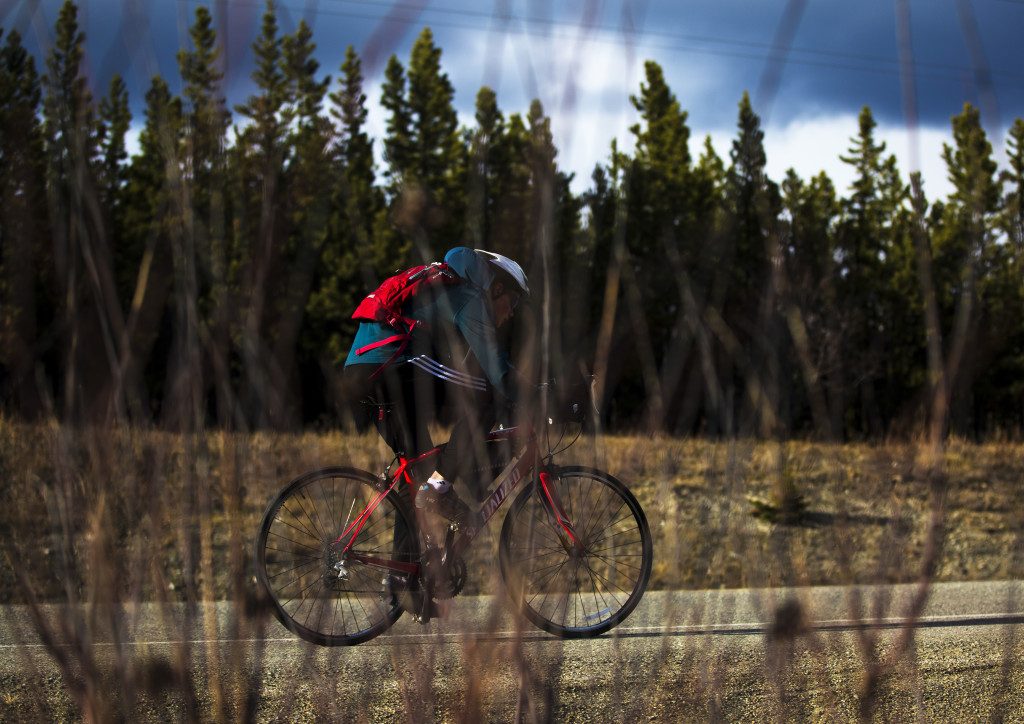 Clayton Chapman pushes up the road during the U Kon Echelon time trial race on the Alaska Highway near the Carcross Cutoff on Weds., May 10, 2017.