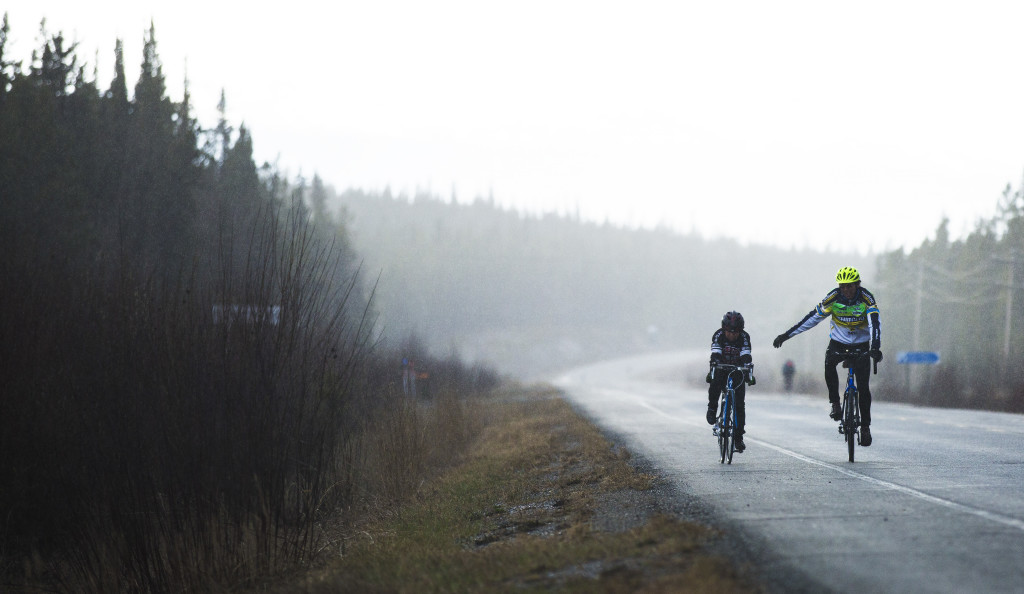 Peter Staley and Johna Irving ride through the rain during the first U Kon Echelon time trial race on the Alaska Highway near the Carcross Cutoff on Weds., May 10, 2017.