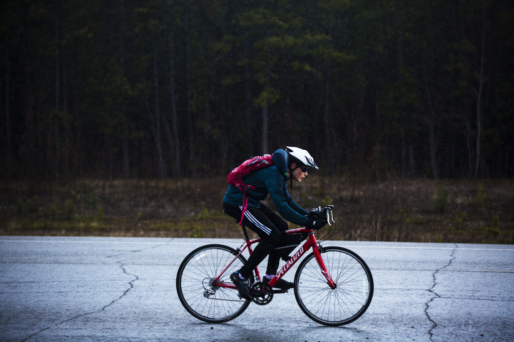 Clayton Chapman rides through the rain during the first U Kon Echelon time trial race on the Alaska Highway near the Carcross Cutoff on Weds., May 10, 2017.