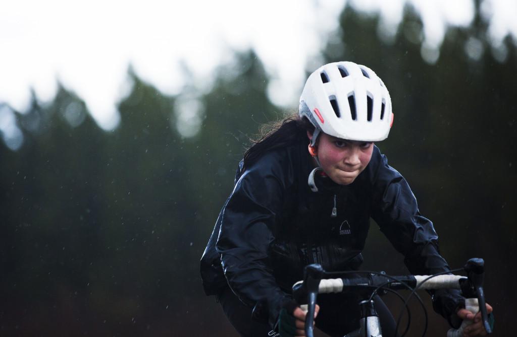 Asha Neumann-Dar rides through the rain during the first U Kon Echelon time trial race on the Alaska Highway near the Carcross Cutoff on Weds., May 10, 2017.