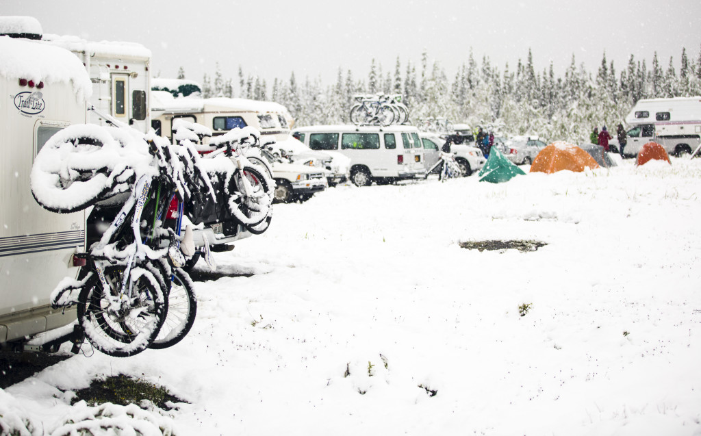 A rest area is full of snow-covered bikes campers and tents south of Haines Junction as snow cancelled the Kluane Chilkat International Bike Relay early Saturday June 17, 2017.