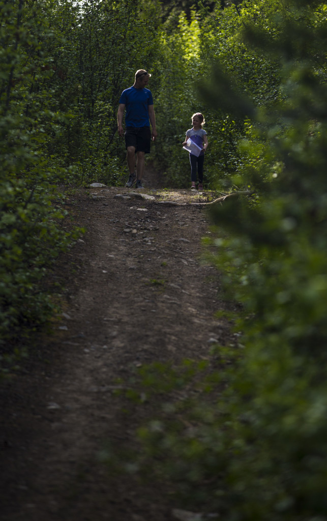 Alastair and Charlotte Smith make their way down the hill to the final control before the finish during the Yukon Orienteering Middle Distance Championships in the Lo-Bird subdivision on Wednesday, June 7, 2017.