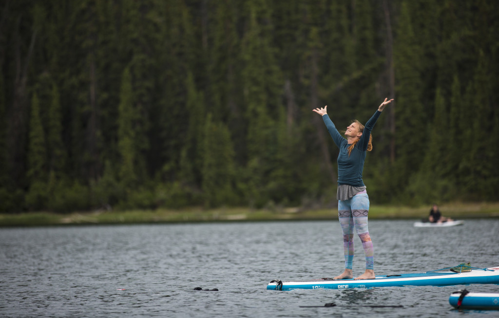 Jessica Read guides a yoga practice on standup paddleboards at Long Lake on June 21, 2017.